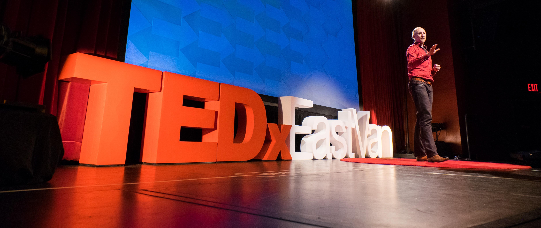 Devon on stage at TEDx EastVan